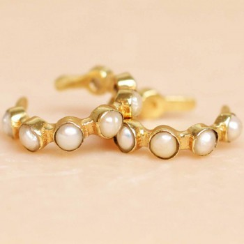 https://www.mujajuma.com/nl/h-earcuff-white-pearl-seven-stones-gold-plated/a10782?c=3491&m=12940
